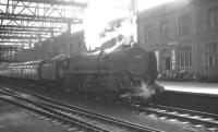 Kingmoor shed's Britannia Pacific no 70002 <I>Geoffrey Chaucer</I> stands in the shadows at Carlisle platform 3 on 18 April 1964. The locomotive has recently taken over the 9.25am Crewe - Perth train. [See image 24632]  <br><br>[K A Gray&nbsp;18/04/1964]
