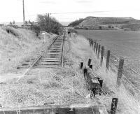 View south towards the Woolmet Colliery bing in the 1980s, with the 3'6� gauge railway laid for the Training Centre on the course of the standard gauge line which served the pit, closed on 2 September 1966.<br><br>[Bill Roberton&nbsp;//]