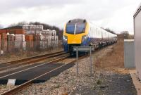 180108 heads to Paddington from Great Malvern on 3 March 2014 passing the site of Blockley station (closed January 1966). Off to the left is the Northcot Brickworks.<br><br>[John McIntyre&nbsp;03/03/2014]