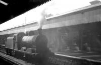 No 48 runs light engine through Portadown station in the summer of 1965. [Ref query 4553]<br><br>[K A Gray&nbsp;28/08/1965]