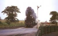 The 2pm Dundee - Glasgow Buchanan Street about to run over Lenziemill level crossing on 3 August 1965. Locomotive in charge is Standard class 5 4-6-0 no 73057.<br><br>[G W Robin&nbsp;03/08/1965]