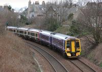 158730 leads the 13.31 from Edinburgh to Dundee away from Aberdour on 16 March.  Trailing is SPT 170478 which is about to be transformed into Saltire livery.<br><br>[Bill Roberton 16/03/2014]