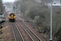 Signs of progress on the electrification of the Whifflet line at Mount Vernon on 17 March as the 0845 service to Glasgow Central approaches the station. Electrification of the line to Whifflet is due to be completed this summer.<br><br>[Colin McDonald&nbsp;17/03/2014]