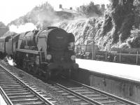 Bulleid West Country Pacific no 34042 <I>Dorchester</I> pulls into the northbound platform at Winchester (then Winchester City) on 15 August 1961 with the 11.16am Bournemouth West - Newcastle Central. [Ref query 5321]<br><br>[K A Gray&nbsp;15/08/1961]