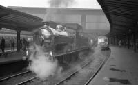 Platform 6 at Carlisle station on 6 April 1963 sees no 256 <I>Glen Douglas</I> at the head of the SLS / MLS <I>Carlisle Railtour</I>. The special visited various lines and branches in and around Carlisle and was hauled throughout by no 256. [See image 23594]<br><br>[K A Gray&nbsp;06/04/1963]