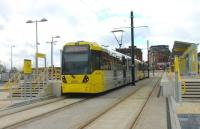 Metrolink trams 3039 and 3053, on a Rochdale to East Didsbury service, call at the new Mumps interchange stop just to the east of Oldham town centre. They will climb through the town before dropping steeply down to rejoin the old railway formation at Werneth. [See image 44114] for a view of this location under construction during the previous summer. <br><br>[Mark Bartlett&nbsp;13/02/2014]