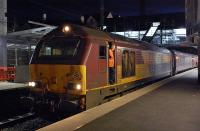 67004 and driver await the right-away at Haymarket with the returning Fife commuter train on the evening of 17 March.<br><br>[Bill Roberton&nbsp;17/03/2014]