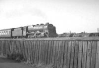 45531 heads south on the WCML past Upperby yards and shed in June 1963. This particular BR boundary fence will be readily recognisable to a number of enthusiasts of a certain age.<br><br>[K A Gray&nbsp;01/06/1963]