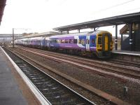 Northern Rail 158850 and a sister unit call at Wakefield Westgate on 20 March with the 07.15 Sheffield - Leeds all stations service via Moorthorpe. <br><br>[David Pesterfield&nbsp;20/03/2014]