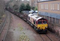 DBS 66115 passes through the site of Newington Station on 18 March with the 6E30 Dalzell - Tees Yard steel empties.<br><br>[Bill Roberton&nbsp;18/03/2014]