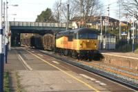 The Carlisle - Chirk loaded log train passes through Leyland on 19 March 2014 with Colas Rail 56094 in charge.<br><br>[John McIntyre&nbsp;19/03/2014]