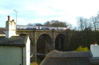 Looking over the rooftops of Knaresborough on 19 March as the 16.45 arrival from Leeds runs out onto the viaduct before crossing over to platform 1 where it will form the 17.05 return service. [See image 23671]<br><br>[Bruce McCartney&nbsp;19/03/2014]