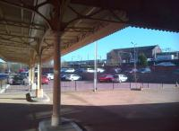 Looking out from the well preserved awning at Wolverhampton Low Level station in the afternoon sun on 16 March, as a class 321 unit draws into the current High Level station in the background. [See image 36283]<br><br>[Ken Strachan&nbsp;16/03/2014]