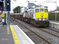 GM 071 class 080 heads north with a freight at Howth Junction on 21 March.<br><br>[Bill Roberton&nbsp;21/03/2014]