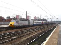 43300 <I>Craigentinny</I> is on the rear of this East Midlands liveried / East Coast branded HST set, as it leaves Doncaster on 28 February with the 09.54 departure to Kings Cross, ex Edinburgh.<br><br>[David Pesterfield&nbsp;28/02/2014]
