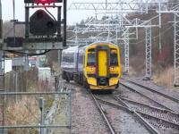 View from the platform at Cumbernauld on 21 February 2014 as a terminated service from Motherwell enters the refuge siding. Changed days.... with colour light signalling and electrification equipment now installed here [see image 10787].<br><br>[Colin Harkins&nbsp;21/02/2014]