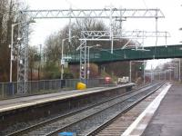 An updated Cumbernauld station on 21 February 2014, complete with new OLE equipment and a new footbridge. Note the extension to platform 1 to accommodate longer electric units.<br> [see image 19133] <br><br>[Colin Harkins&nbsp;21/02/2014]