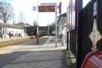 Platform view south at Horsforth station on 19 March with the 15.12 service to Knaresborough just appearing below the road bridge in the background. Note the three quarter mile post on the right. <br><br>[Bruce McCartney&nbsp;19/03/2014]