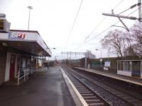 Platform view north east at Cumbernauld on 21 February 2014, with the old footbridge now removed and overhead line equipment installed.<br><br>[Colin Harkins&nbsp;21/02/2014]
