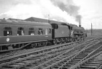The combined 2pm ex-Glasgow Central/2.5pm ex-Edinburgh Princes Street leaves Carlisle on 7 August 1965 with through coaches for Manchester and Liverpool. In charge is Jubilee no 45684 <I>Jutland</I> of Bank Hall shed. <br><br>[K A Gray&nbsp;07/08/1965]