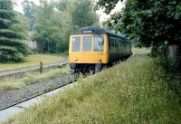 A DMU for Llandudno arrives at Betws-y-Coed from Blaenau Ffestiniog in July 1991.<br><br>[Colin Miller&nbsp;/07/1991]