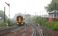 An early afternoon Edinburgh Waverley - Dunblane ScotRail service heads north away from Larbert in May 2005 during a period of exceptionally heavy rain.<br><br>[John Furnevel&nbsp;25/05/2005]