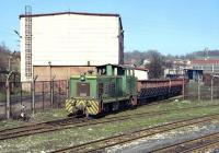 In addition to three B-B diesel hydraulics of class 740, the Banovici coal railway possesses three 4w shunters of class 720, which are employed at the loading point at Turija and here at the works in Banovici. On 14 March no. 720 003 emerges from the works yard with two hopper wagons which have been receiving attention.  The main part of the works seems to handle wagons and steam overhauls, while the tall building behind the loco deals with maintenance of the diesel fleet.<br><br>[Bill Jamieson&nbsp;14/03/2014]
