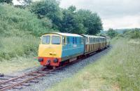 Diesel-hydraulic <i>Merionnydd</i> approaches the eastern terminus at Bala (Penybont) - formerly Bala Lake Halt on the GWR line from Ruabon to Barmouth junction.<br><br>[Colin Miller&nbsp;/07/1981]