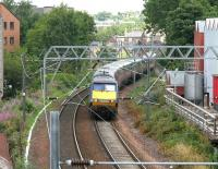 A GNER Kings Cross - Glasgow Central service photographed shortly after leaving the E&G main line at Haymarket East Junction in July 2006. The train is about to pass below Slateford Road heading south west towards Carstairs.<br><br>[John Furnevel&nbsp;27/07/2006]