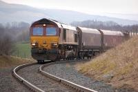 DBS 66100 grinds uphill towards Boig Road level crossing on 31 March 2014 with coal empties from Carlisle to Greenburn loading point. [Ref query 4651]<br><br>[Bill Roberton&nbsp;31/03/2014]
