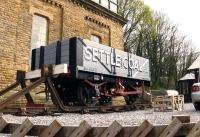 An ideal garden ornament for the discerning railway enthusiast! This 5 plank wagon in the grounds of the converted water tower at Settle station now greets visitors as they enter the station car park. [See image 42204]<br><br>[Colin McDonald&nbsp;09/04/2014]