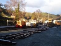 Diesel loco and rolling stock, including what appears to be a works mess unit, are seen in this view over Llanfair Caereinion yard, looking towards the station, during the winter closure period.<br><br>[David Pesterfield&nbsp;20/01/2014]