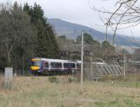 Passing through the ornate bridge over the River Tilt, 170405 slows to call at Blair Atholl on 5 April. The Turbostar was on a Glasgow Queen Street to Inverness service.<br><br>[Mark Bartlett&nbsp;05/04/2014]