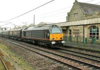 67005 <I>Queen's Messenger</I> heads the Royal Train northwards through Carnforth on 9 April 2014 conveying HRH The Prince of Wales to Oxenholme on a visit to Cumbria. <br><br>[Mark Bartlett&nbsp;09/04/2014]