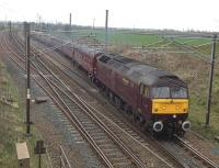 A West Coast class 47 brings the 06.47 ex-Cleethorpes <I>'Edinburgh - Settle & Carlisle'</I> special out of Quintinshill down loop on 12 April 2014. The train was scheduled to return south from Edinburgh later in the day via the ECML.<br><br>[Kevin McCartney&nbsp;12/04/2014]