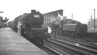 Scene on platform 1 at Carlisle on 4 August 1962, as Stanier Princess Pacific no 46208 <I>Princess Helena Victoria</I> comes off the recently arrived 9.20am Crewe - Aberdeen. Standing in the west sidings is Ivatt 4MT 2-6-0 no 43027.<br><br>[K A Gray&nbsp;04/08/1962]