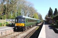 A sunny afternoon on the West Somerset Railway on Sunday 13 April 2014, as an eastbound DMU calls at Crowcombe Heathfield. The train is on its way to Bishops Lydeard.<br><br>[Peter Todd&nbsp;13/04/2014]
