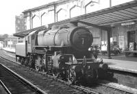 One of Kingmoor shed's Ivatt 4MT 2-6-0s no 43103 idles alongside platform 1 at Carlisle in the summer of 1963. Affectionately referred to as <I>'Flying Pigs'</I> by some enthusiasts, an example of the class is now preserved on the Severn Valley Railway [see image 25291].<br><br>[K A Gray&nbsp;03/08/1963]
