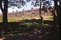 Surviving dwelling houses in the railway village at Riccarton Junction in Spring 1966. In 1949-50 all 33 railway houses and the School House had been occupied, but by the time of this photo - two years after the school closed and a year after the Co-op shut its store on the station platform - just a dozen houses remained in occupation. The closure proposal for the Waverley Route came in August 1966 and by the following year a further third of the houses had been abandoned. The writing was on the wall for Riccarton.<br><br>[Frank Spaven Collection (Courtesy David Spaven)&nbsp;//1966]