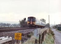 1988 - when men were men... and 155308 was factory fresh. The DMU is heading North from Newport towards Cwmbran, past the site of Ponthir station. That yellow number in the foreground would be a milepost, not a TOPS number.<br><br>[Ken Strachan&nbsp;/09/1988]