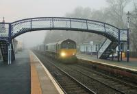 Inverness bound Tesco containers rolling north through Pitlochry behind 66430 early on a misty morning in April 2014. <br><br>[Mark Bartlett&nbsp;05/04/2014]