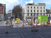 Construction of on an extension to Dublins Luas Green Line to Broombridge in the north west of the city.  The route will bisect the Red Line and run northwards along O'Connell Street and southwards along  parallel Marlborough Street crossing the Liffey on a new bridge, seen here on 22 March 2014 with track in place. [Ref query 6451]<br><br>[Bill Roberton&nbsp;22/03/2014]