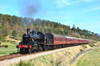 Strathspey Ivatt 2-6-0 No.46512 photographed south of Broomhill on a sunny 19 April with the 13.30 for Aviemore.<br><br>[John Gray&nbsp;19/04/2014]