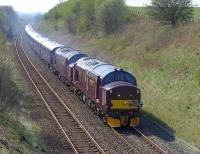The northbound <I>Royal Scotsman</I>, hauled by West Coast 37685 and 37516, photographed near the site of Crossgates Station on 21 April en route from Edinburgh to Keith.<br><br>[Bill Roberton&nbsp;21/04/2014]