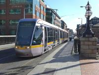 Luas Red Line tram 4012 crosses the Royal Canal on 23 March having just called at the George's Dock stop.<br><br>[Bill Roberton&nbsp;23/03/2014]
