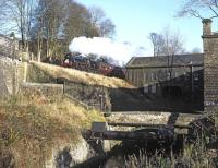 Black 5 No. 45305 forges uphill past Vale Mill with a mid-day <I>Santa Special</I> from Keighley on 30 November 2013.<br><br>[Bill Jamieson&nbsp;30/11/2013]