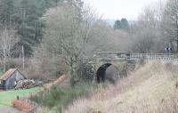 The A827 road from Aberfeldy still crosses the branch line trackbed at Grandtully on this narrow overbridge, controlled by traffic lights. The line closed in 1965, two months short of its centenary. View towards Ballinluig on 6 April 2014. <br><br>[Mark Bartlett&nbsp;06/04/2014]