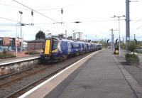 The 10.30 from Glasgow Central, formed by 380002, arrives at Ayr platform 1 on 25 April 2014.<br><br>[Colin Miller&nbsp;25/04/2014]