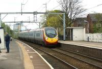 A London to Carlisle Pendolino runs through Patricroft on 19 April after being diverted via Manchester due to engineering work on the WCML in the Warrington area.<br><br>[John McIntyre&nbsp;19/04/2014]