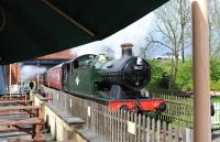 Scene on the Swindon and Cricklade Railway on 26 April 2014 with ex-GWR 0-6-2T no 5637, currently on loan from the East Somerset Railway, departing with a train for Taw Valley Halt.<br><br>[Peter Todd&nbsp;26/04/2014]